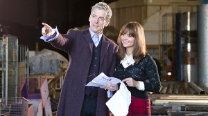 Peter Capaldi, on set incostume as the  Eleventh Doctor, with Jenna Coleman
