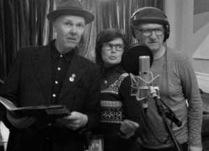 Trev, Simon and Sophie recording a previous episode in classy black and white