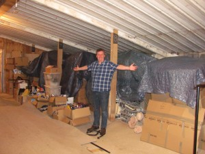 David With Boxes of Collectibles at the Museum's Location